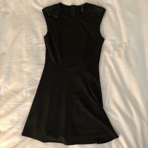 Black dress with sequenced shoulders